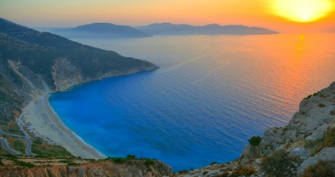 Sunset over the beautiful beach of Myrtos, Kefalonia, Greece